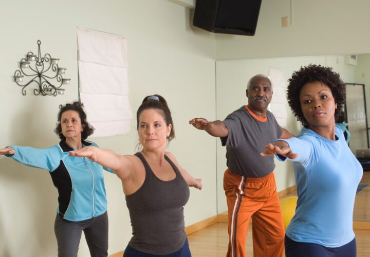 Middle age and senior people taking yoga class