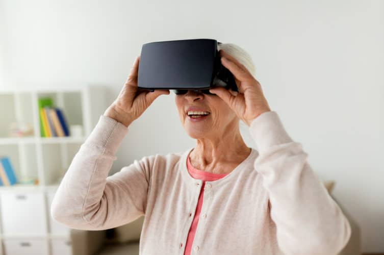 older woman in virtual reality headset