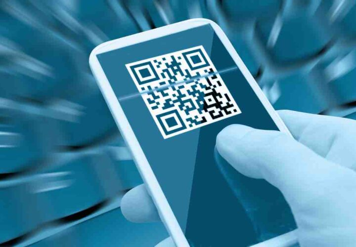 Reading QR Code With Smartphone in Man's Hand