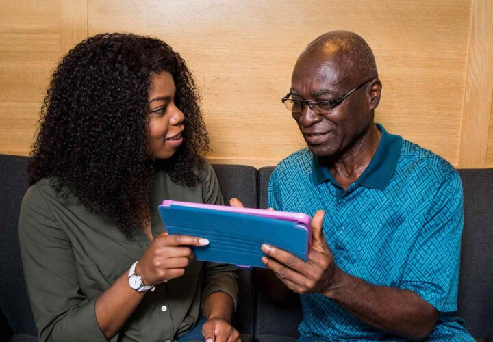 woman and her father using my house of memories app for dementia