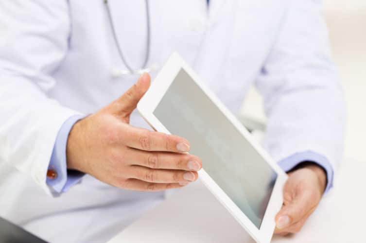 doctor holding electronic tablet in hands