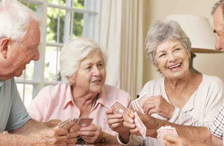group of seniors playing card game